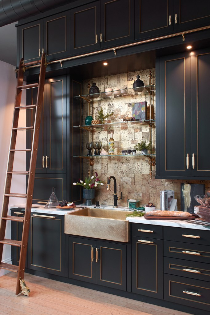 black and brass loft kitchen with rolling library ladder