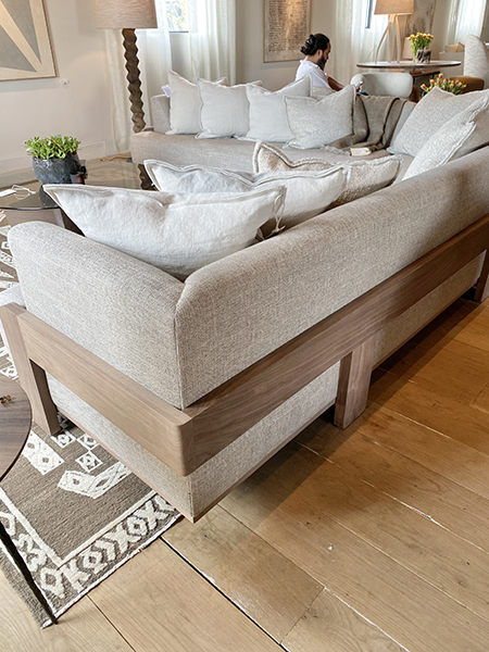 Sofa with unfinished walnut frame - High Point Market furniture trends 2021