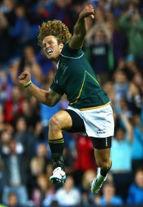 GLASGOW, SCOTLAND - JULY 27:  Werner Kok of South Africa jumps in the air to celebrate their win over New Zealand during the final match between South Africa and New Zealand at Ibrox Stadium during day four of the Glasgow 2014 Commonwealth Games on July 27, 2014 in Glasgow, United Kingdom.  (Photo by Julian Finney/Getty Images)