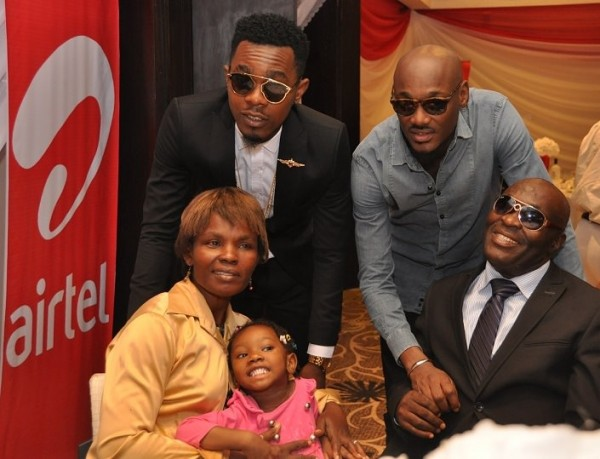Airtel Brand Ambassadors, Patrick Okorie a.k.a 'Patoranking' and Tuface Idibia with Airtel Touching Lives Season 1 beneficiary, Mr. Essienkan Ebong and his family, during the launch of Airtel Touching Lives Season 2 held in Ikoyi, Lagos.