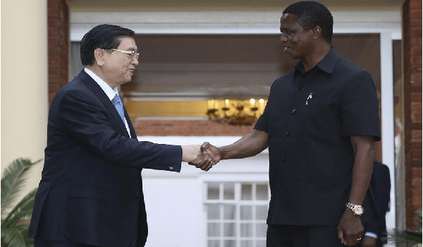 - Zhang Dejiang (L), chairman of the Standing Committee of China's National People's Congress (NPC), shakes hands with Zambian President Edgar Lungu in Lusaka, capital of Zambia, March 19, 2016. Zhang paid an official goodwill visit to Zambia on March 18-22. (Xinhua/Ma Zhancheng)