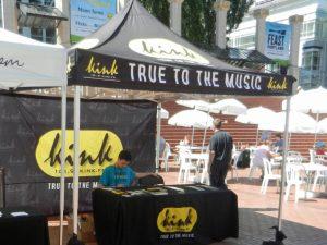 intern texting at kink radio promo tent