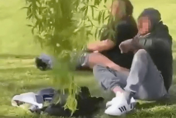 couple chopping themselves in the park
