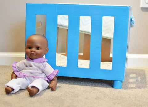 Reuse a box to create a DIY baby doll crib for hours of fun!