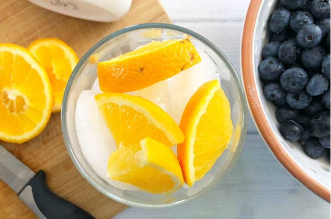 Learn How to Become a Morning Person with a glass of fruit infused water and 5 simple steps.