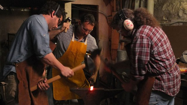 Tom Pulllin, Davide Prete, and Jeremiah Holland forging. Mark Markley photograph