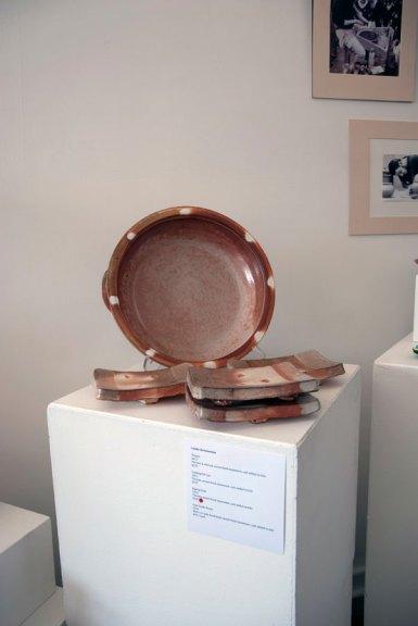 Linda Christianson, Baking Dish, 2013. Thrown, wood-fired stoneware, salt added to kiln; 4 sushi plates, 2013. Wire cut slab, hand built, wood-fired stoneware, salt added to kiln, Madison Metro photograph