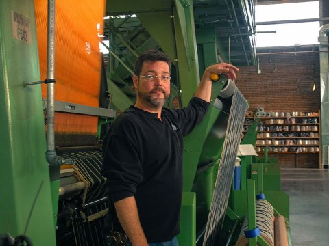 Loom overhauler Barry Connor operates the looms at The Oriole Mill