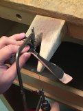Filing excess metal using a coping saw
