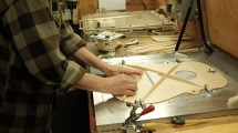 Anette Pemberton works on the X bracing. Mark Markley photograph