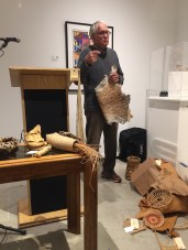 Jim Bassler spoke of his experiences teaching in Southern California while demonstrating weaving techniques and objects from cultures around the world.