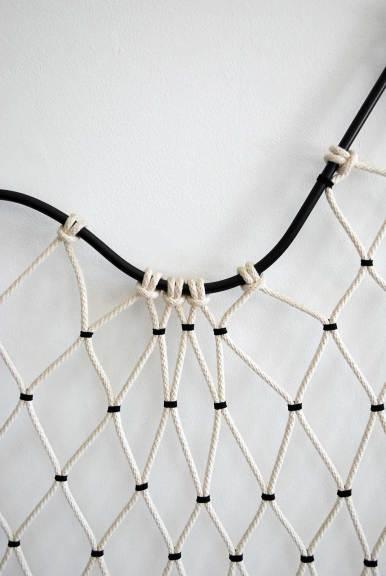 Tanya Aguiñiga, Round Hammock Settee (detail), 2012. Steel rod, leather, cotton rope