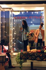 Spoken word poets share there creativity on the Center's window stage.