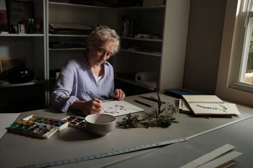 Mary Merkel-Hess sketching plants from her yard