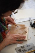 Participant carving a bird design into her linoleum block for her Valentine Design.