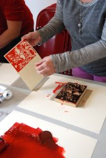 Using red or black ink, participants used their blocks to create a series of printed cards.