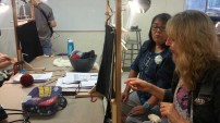 Lynda Teller Pete works with a weaving student