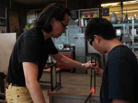 Mark Mitsuda assists a student. Mark Markley photograph