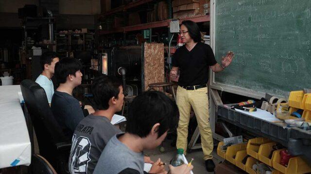 Mitsuda explains concepts of glass. Mark Markley photograph