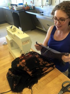 Kristen Sauers is creating a blouse to wear under her silk rope necklace