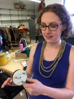 Kristen with her necklace and the tool she used to make it