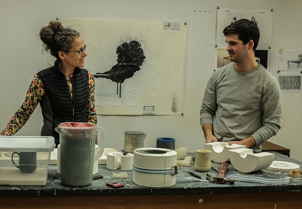 Linda Sikora, Professor of Ceramic Arts at Alfred University, works with graduate student, Lea Griggs