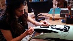 Brittaney carefully cuts out Preston's designs
