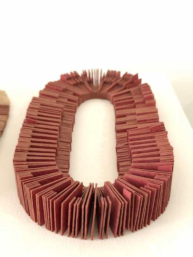 Kiff Slemmons, Collective Presence, Laser Collars (2), 2017. Laser cut handmade paper, elastic cord, Craft in America
