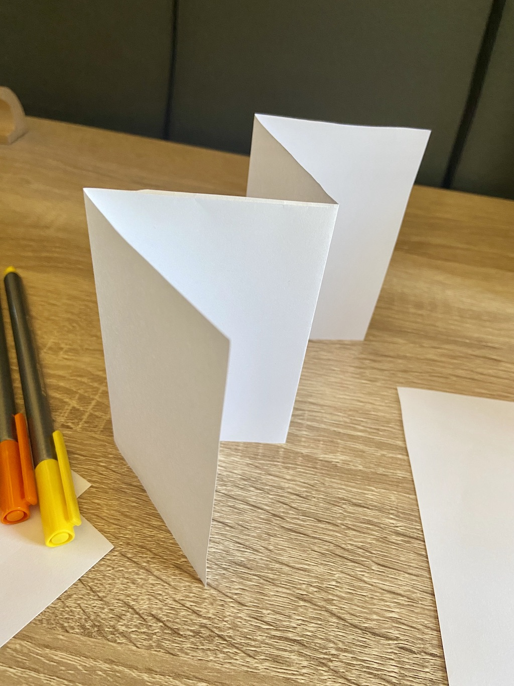 Flip over the paper and do the same fold. Your paper should now look like a W.