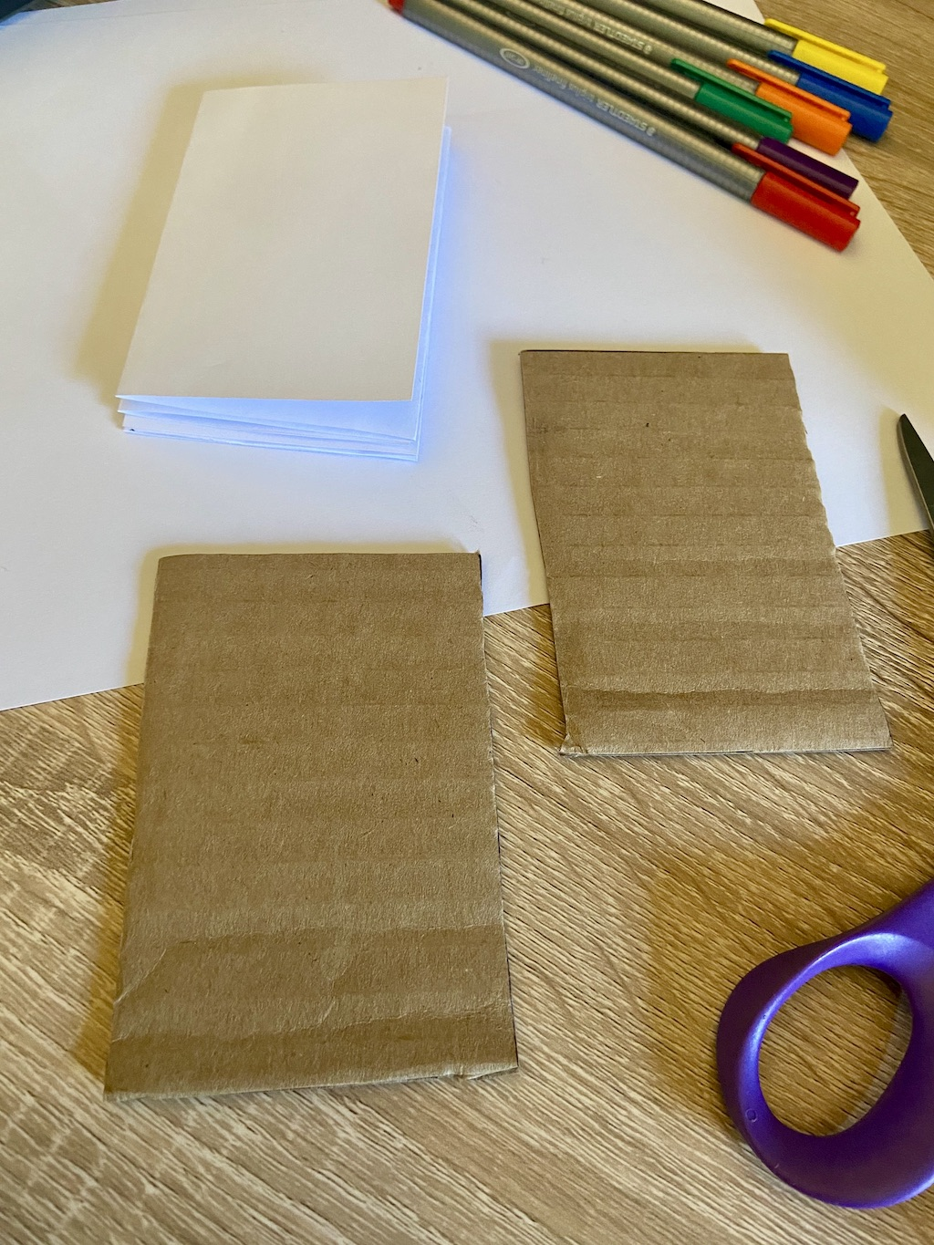 To make your book cover, take two pieces of cardboard or cardstock (you can cut up cereal boxes too!) and cut them to the same size as the accordion.