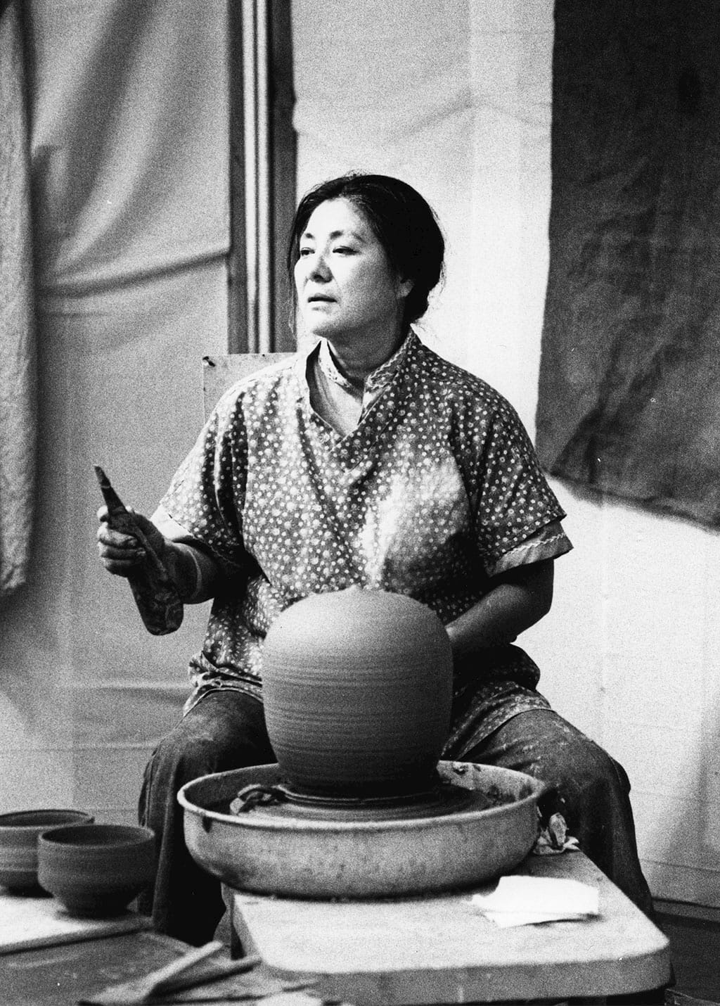 Toshiko Takaezu at the wheel. Courtesy of the American Craft Council