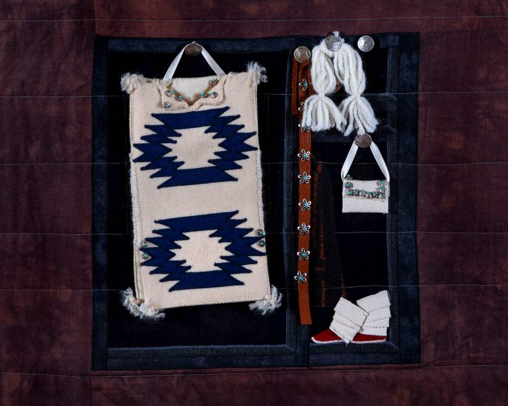 """Susan Hudson, MMIW Since 1492, 2018. Cotton fabric, batting, thread, commercial buttons, leather; 94 x 54 x 1/2"""" Image courtesy of the artist. Photograph by Tad Fruits. Craft in America Center Democracy"""