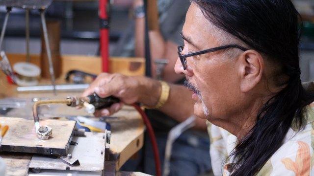 Jesse Monongya. Denise Kang photo. JEWELRY episode of Craft in America