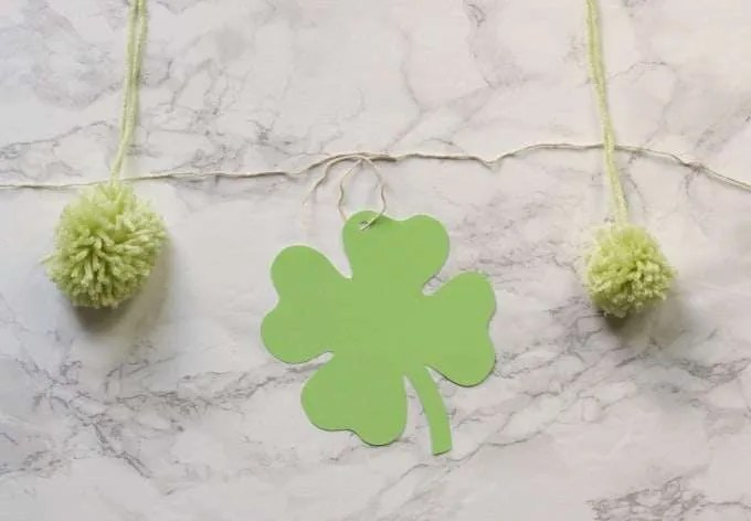My DIY project for the month of March is in memory of our family shamrock. I found this beautiful Cricut image on Cricut design space.  I also just purchased a cute quick and easy pompom maker after reading Keystoinspiration.com and this is the perfect project to make a lot of pompoms.