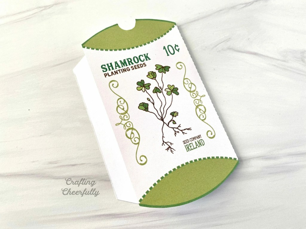 The Shamrock pillow box is folded in half along the dotted fold line.