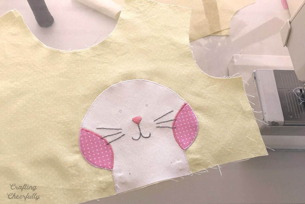 Handmade Bunny Dress with Cute Bunny Applique. Process picture of bunny applique being added.