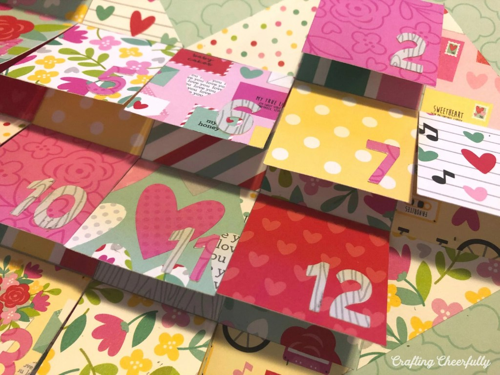 Add numbers to each flap of of the Valentine's Day countdown.