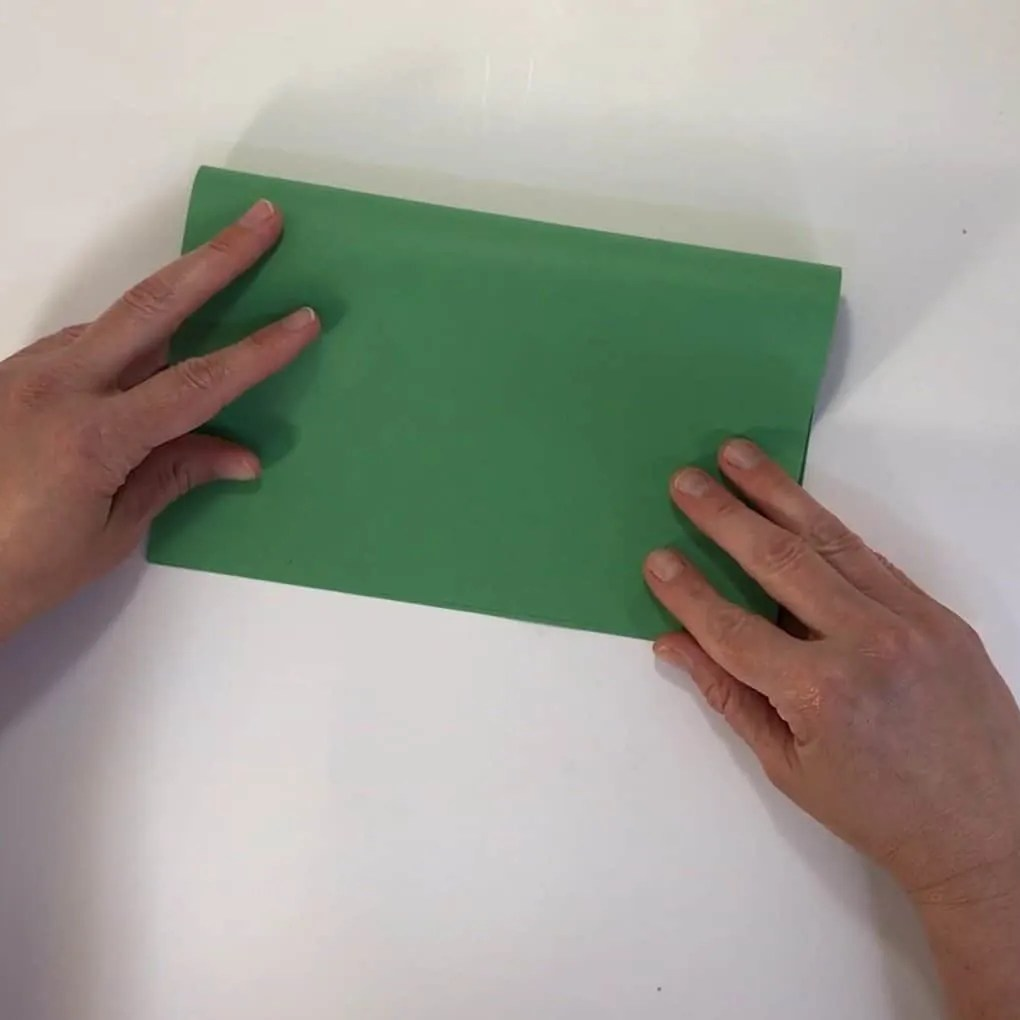 Fathers day football craft fold green paper in half