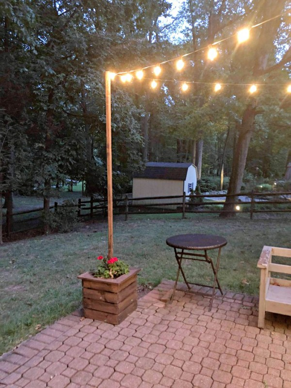 diy-string-light-poles-planters-outdoor-lights