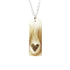 Heart memorial necklace filled with your pet's hair and ashes