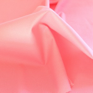 Small White Spots on Pink Fabric Material