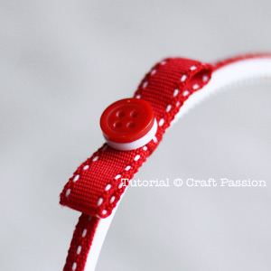 Attach button on ribbon bow