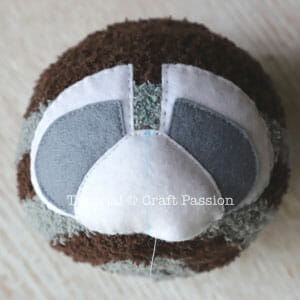 sewing sock raccoon face