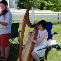 Nicholas Trevits & Mary Lovegrove perform at the Craftsbury Farmers Market