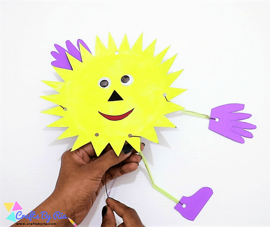 paper plate sun-attach the legs with 3 pieces of straw