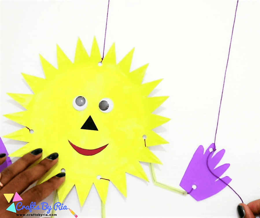 paper plate sun-punch holes on the hands and attch to the cardboard