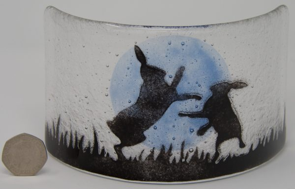 Hares boxing by moonlight