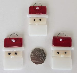 hand made glass Santa faces