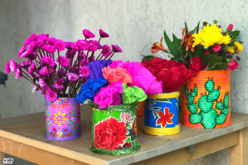 Painted tin cans by Crafty Chica.