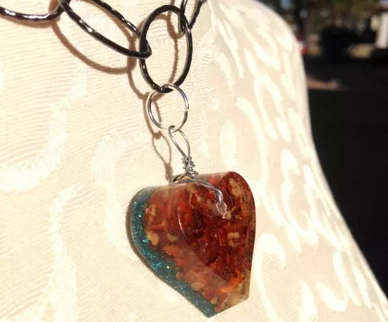 Crushed red peppers in resin pendant.
